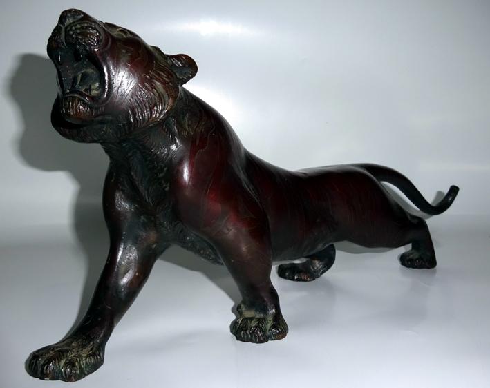 brass sculpture repair lion